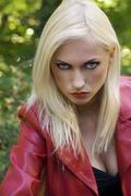 Blond girl anger in park Stock Photos