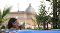 luxury spa - woman on the cell phone in jacuzzi - view of saint peter - wine HD Footage