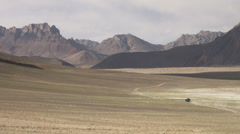 Pamir mountains jeep solitude nature spectacular landscape scenery - stock footage