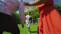 Happy asian family playing sports and having fun in the garden on a summer day - stock footage