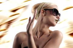 fashion shot of blond woman with sunglasses - stock photo