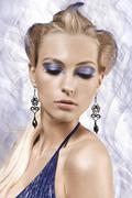 portrait of a girl with fantasy make up and hair style - stock photo