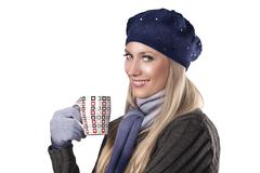 Winter fashion girl holding a hot cup of tea Stock Photos