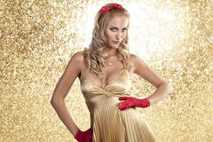elegant christmas girl in a champagne color dress - stock photo