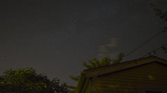 Night sky and stars over house - stock footage
