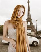 Stock Photo of blond girl in elegant dress, she has the scarf on the head