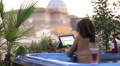 luxury spa - woman surfing in internet on tablet in whirlpool bath - jacuzzi Footage