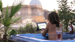 Luxury spa - woman surfing in internet on tablet in whirlpool bath - jacuzzi Stock Footage
