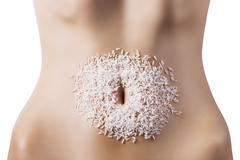 composition of cereals over belly - stock photo
