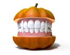 Stock Illustration of pumpkin split with vampire teeth