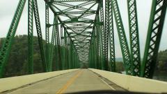 Old green iron steel bridge mountain lake drive thru Stock Footage