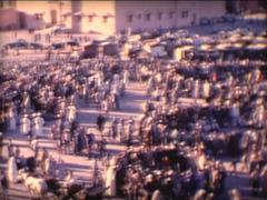 8MM MOROCCO - Marrakech Gnawa music group on place Jemaa el-Fnaa - 1963 Stock Footage
