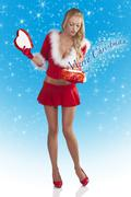 Santa claus girl opening box Stock Photos