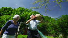 Family and friends of many generations having fun in the garden on a summer day - stock footage