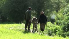People take their donkey back to the village in remote rural Tajikistan Stock Footage