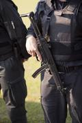 Armed policeman Stock Photos
