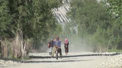 Riding donkey through Tajik village Stock Footage