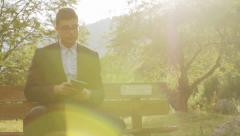 Happy Working Man In Suit in Nature Park Sun Flare HD Stock Footage