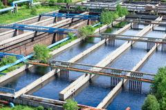 floating surface aerators tanks on sewage treatment plant - stock photo