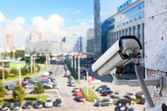 video surveillance cameras for monitoring on streets - stock photo