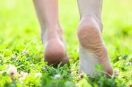 Stock Photo of bare feet on the soft summer grass