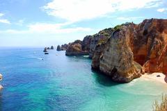Cliffs at the dona ana beach, algarve coast in portugal Stock Photos