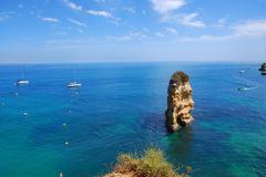 cliffs at the dona ana beach, algarve coast in portugal - stock photo