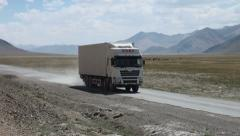 Chinese cargo truck drives across Pamir, international development assistance Stock Footage