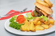 Stock Photo of Hamburger on a plate with Annex