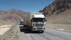 Pamir Highway, Chinese cargo trucks, import, trade, relations, development Stock Footage