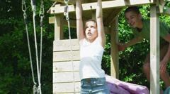 Happy young friends play together at a playground on a summer day Stock Footage