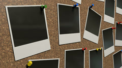 Polaroids on cork board animation pan Stock Footage