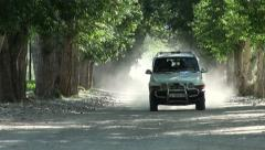 Tajikistan, Wakhan Valley, jeep, man, dust, road Stock Footage