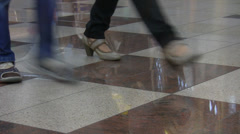 Leg reflections on a shiny floor Stock Footage