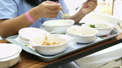 Patient girl have soft special meal on bed in hospital Stock Footage