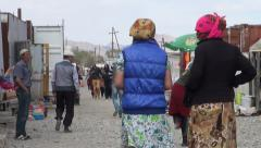 Bazaar in rough little town in Tajikistan, marketplace in remote location Stock Footage