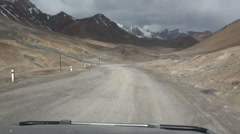 Driving through the Pamir ranges in a four wheel drive jeep, across dirt roads - stock footage