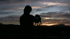 Photographer at sunset waiting for the moment Stock Footage