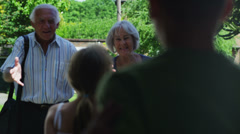 Happy grandparents arrive for a visit with their family Stock Footage