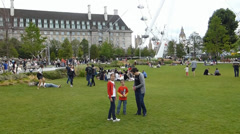 Visitors at Jubilee Gardens, London, UK. (LONDON EYE 12a) Stock Footage