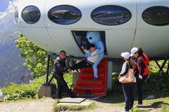 Alien stealing a little boy near the ufo Stock Photos