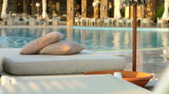 Beach loungers and floating in the pool, the woman Stock Footage