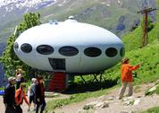 Stock Photo of people around ufo the landing between caucasus mountains