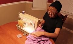 Seamstress Sewing Garment - stock photo