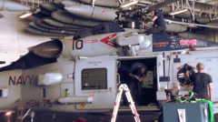 Crew Working On HS-60 01 Stock Footage