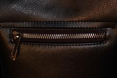 Zipper on dark brown leather hand bag Stock Photos