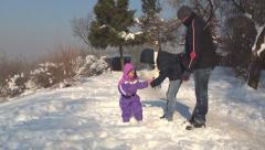 Mother, Father, Child Playing in Snow, Family with Girl Have Fun in Snow, Winter Stock Footage