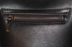 Zipper on dark brown leather hand bag Stock Photos