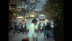 Stock Video Footage of San Francisco 1976: cable car in a crowdy street