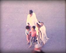 8MM MOROCCO - woman  kid walkin on Jamaa el Fna place Marrakech - 1963  - 1963 Stock Footage
